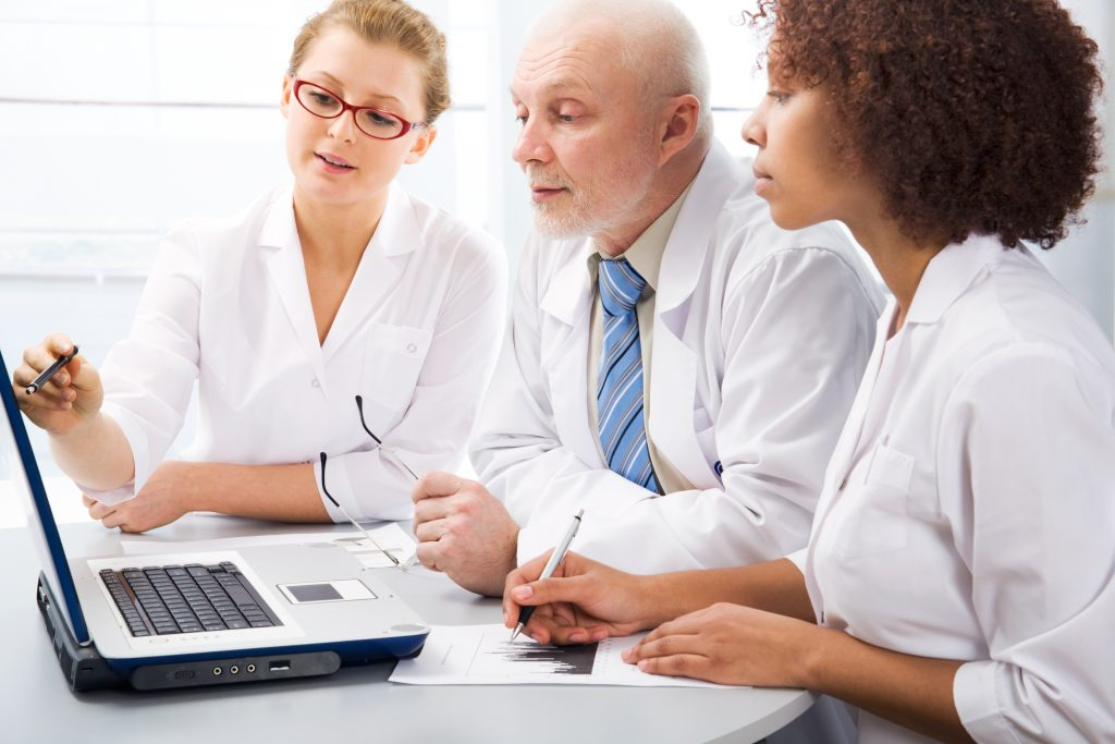 Group of doctors discussing MIPS at their office